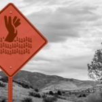 Data overwhelm - Road sign depicting a person drowning in ones and zeroes